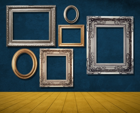 room with frames on blue wall. photo