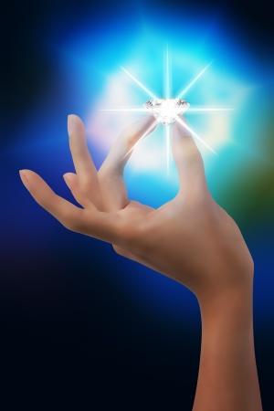 dazzlingly:  hand nip flashing diamond in dream Stock Photo