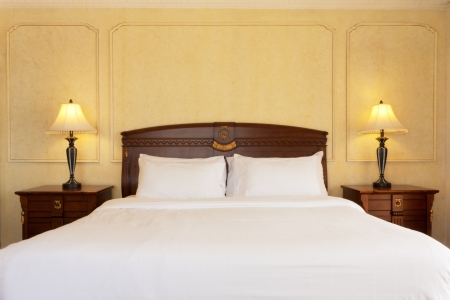 luxury bedroom with classic wood furniture