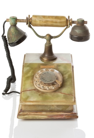 old telephone with reflex on white Stock Photo - 20143937