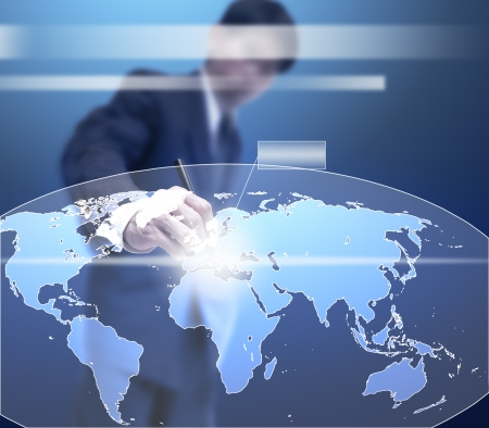 businessman point on virtual global map. photo