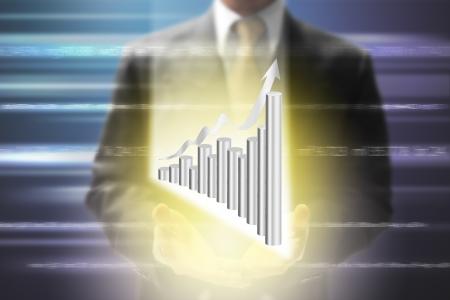 businessman show virtual platinum graph.