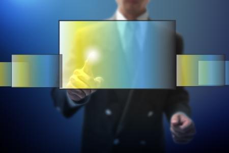 cake pick: businessman point on virtual monitor.