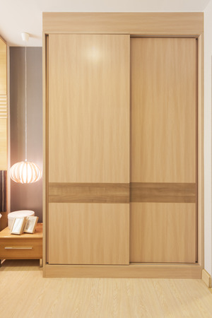 sliding doors wardrobe furnishing in small room.