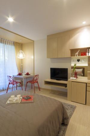 modern bedroom: modern bedroom with dining corner. Stock Photo
