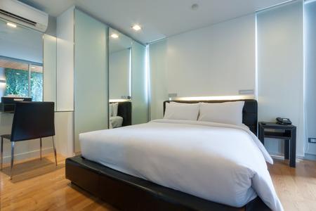 luxury bedroom: luxury white bedroom in apartment.