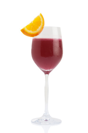 mocktail: red mocktail in wine glass with orange isolated on white.