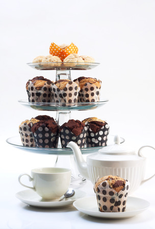 dessert stand: cupcakes with three tiered tray and tea set.