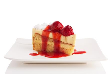strawberry cheesecake isolated on white. photo