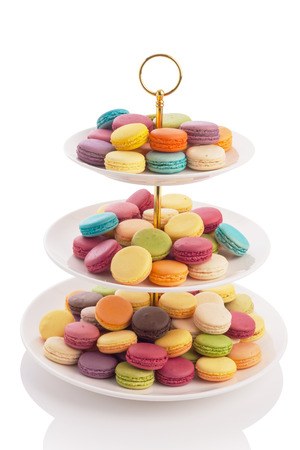 tier: macarons on three tier serving tray isolated on white.
