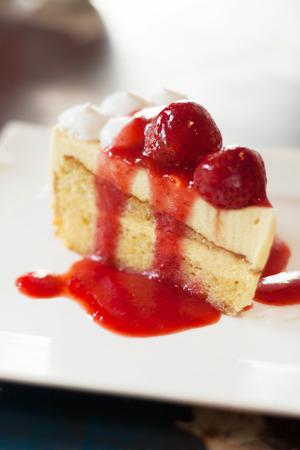 ambrosia: closeup strawberry cheesecake on table.