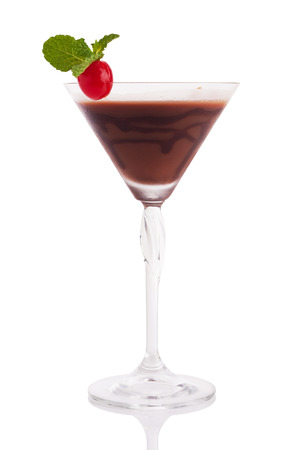 glass topped: chocolate martini with cherry and mint isolated on white. Stock Photo