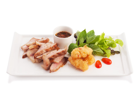 broiled: Charcoal Broiled Pork Neck with Jaew thai style spicy sauce and fried sticky rice isolated on white. Stock Photo
