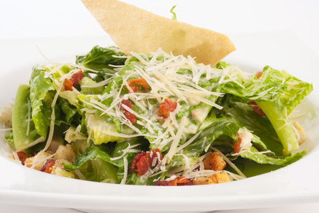 crouton: organic caesar salad with cheese and crouton isolated on white.
