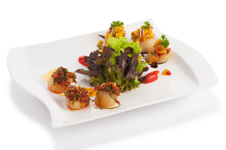 spicy scallops and lettuce isolated on white with clipping paths. photo