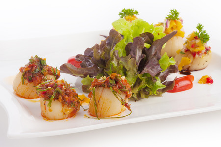 spicy scallops and lettuce on white. photo