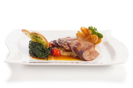 potato fries: roast duck with sauce, mashed potato and potato fries on plate isolated on white.