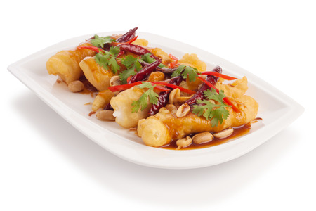 topped: Fried Shrimp plate with fried dough topped with sweet sauce isolated on white. Stock Photo