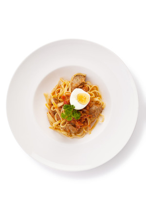 chilli sauce: spaghetti with chilli sauce, grilled sausage named sai-aue and boiled egg isolated on white.