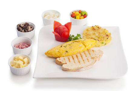 hashbrown: Omelette or scrambled egg served with hash-brown and tomato, isolated on white.