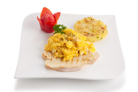 hashbrown: Scrambled egg served with hash-brown and tomato, isolated on white. Stock Photo
