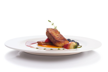 foie gras: Foie gras with raspberry and mango reduction, isolated on white.
