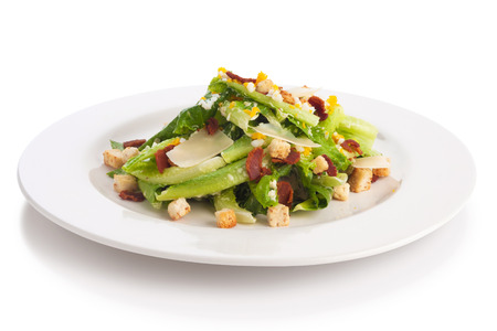 crouton: Caesar salad with quail egg, crouton, crispy bacon, isolated on white.