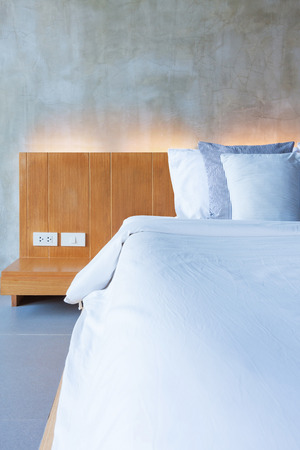 cement interior style in bedroom, modern wood bed. Stock Photo