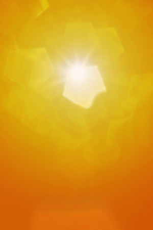 abstract sun in gold color with lens flare and pentagon bokeh.