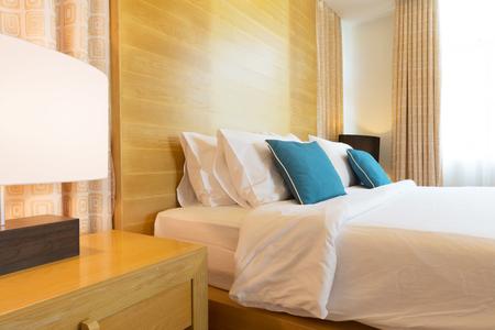 luxury bedroom: luxury contemporary bedroom decorated with wood. Stock Photo