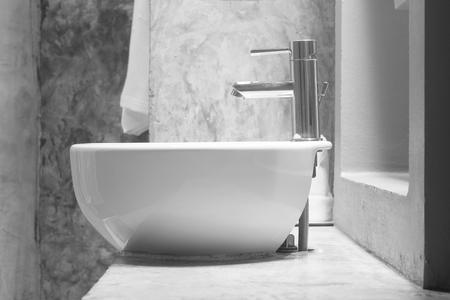 wash basin: white wash basin on cement countertop.