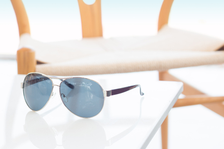 male sunglasses on white table.