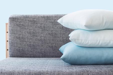 light color pillow on sofa.