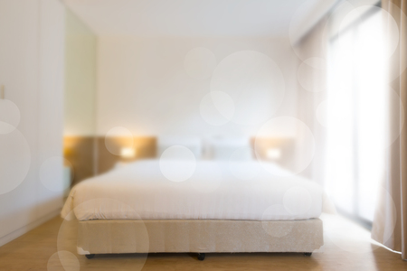 abstract comfortable bedroom in blurred vision and bokeh.