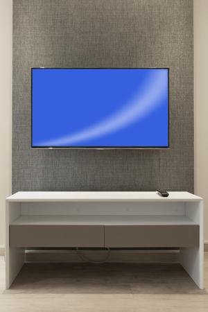 LED tv on wall in hotel room. Lizenzfreie Bilder