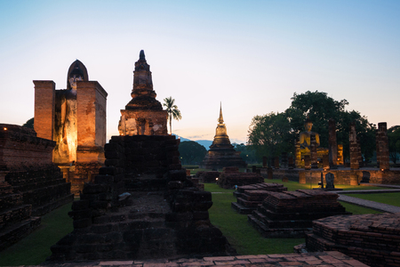 In the twilight of The ancient temple Wat Mahathat in Sukhothai Historical Park, Sukhothai province, Thailand Standard-Bild