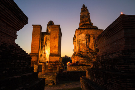 When the sun fall at The ancient temple Wat Mahathat in Sukhothai Historical Park, Sukhothai province, Thailand.