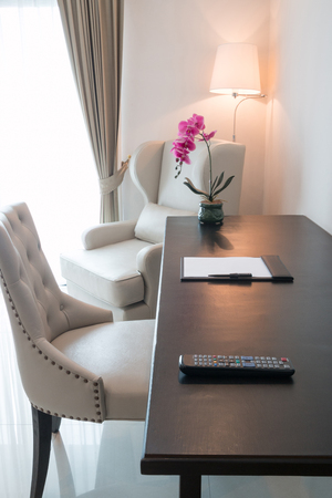 Working table in cozy hotel-room, Thailand.