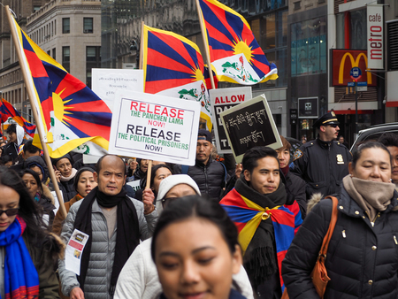 New York, NYUSA - March 10 2018: Tibetan protesters march in New York City on the annual Tibetan Uprising Day, commemorating the failed 1959 uprising against China