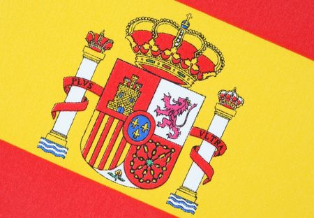Cropped close-up of the coat of arms on the Spanish flag. Horizontal shot.