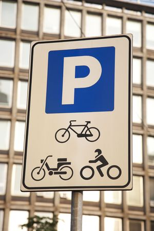 Urban parking sign for bicycles and motorbikes photo