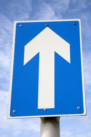 White one way traffic sign against blue sky background photo