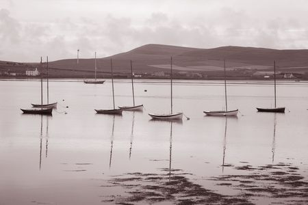 Boats in Orkney Islands, Scotland in sepia black and white tone photo
