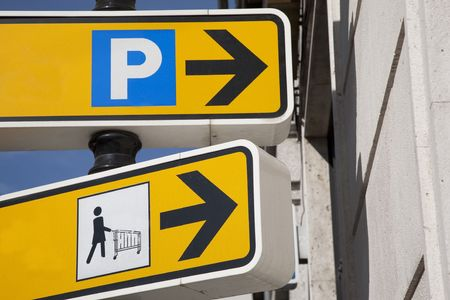 Close up of a Shopping and Parking Sign in Urban Setting Stock Photo - 8207658