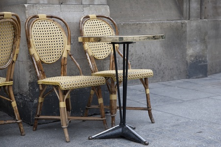 Two Cafe Chairs on a Terrace in Paris, France Stock Photo