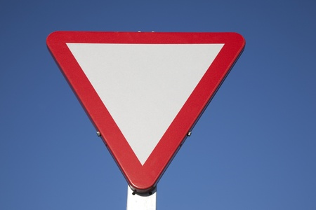 Blank Give Way Sign against Blue Sky Background Stock Photo - 8745924