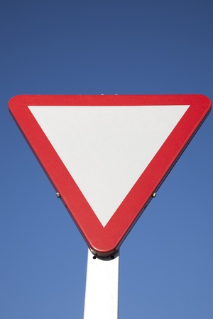 Blank Give Way Sign against Blue Sky Background Stock Photo - 8745923