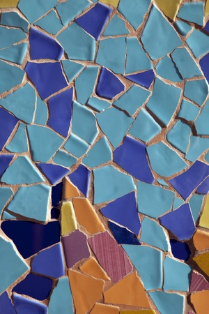 Colorful Blue and Yellow Mosaic Background Design on Shop Front in Barcelona, Catalonia, Spain Stock Photo