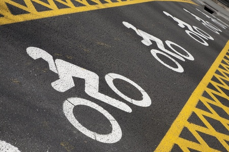 Motorbike Symbols in a line across the street Stock Photo - 9183402