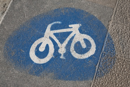 Blue and White Bike Lane Sign Painted onto the Street Stock Photo - 9183467